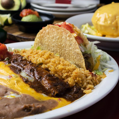 Taco served with rice, meat, salad and different types of sauce to order in Marshall Texas