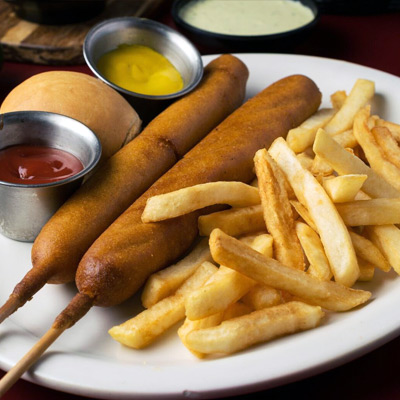 Hot dogs served with fried potatoes, mustard and ketchup to order in Marshall Texas