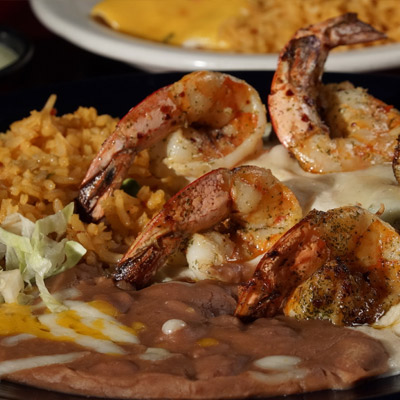Mexican dish with shrimps, rice and chili sauce to order in Nacogdoches Texas