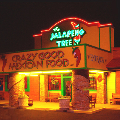 Exterior night look of the Jalapeno Tree restaurant in Mineola