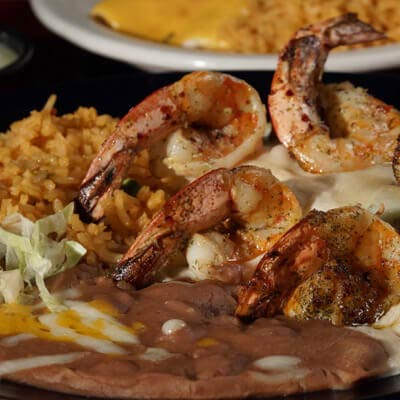 All Mexican favorites are served with spanish rice and refried beans